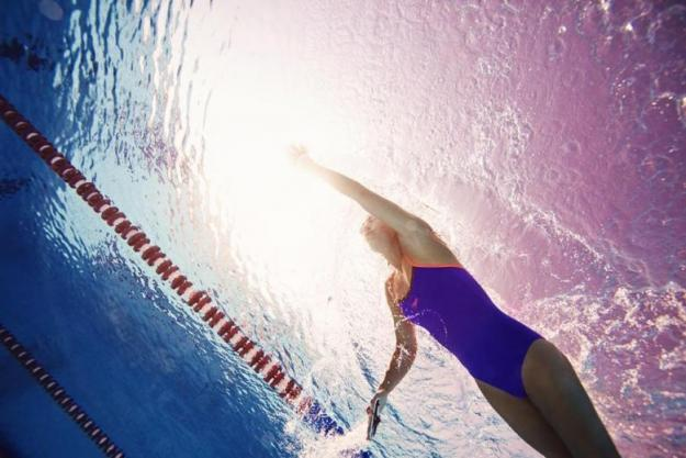 An underwater photo of a woman swimming breaststroke