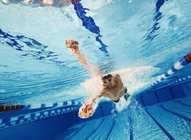 Underwater shot of a man swimming breaststroke