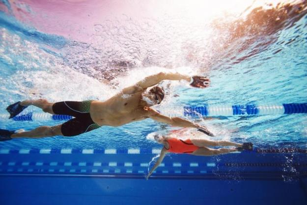 Underwater photo of two swimmers in action