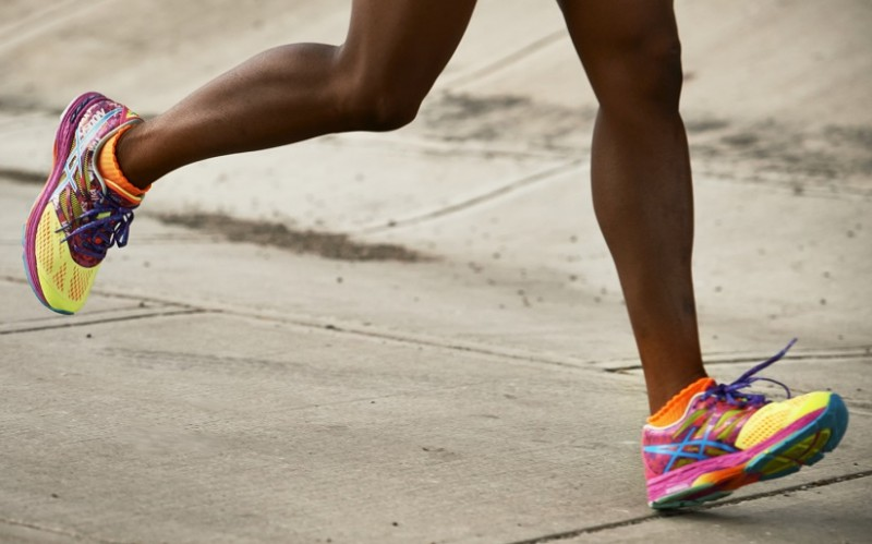 Image of runner s legs in motion wearing ASICS running shoes 819f7aac75