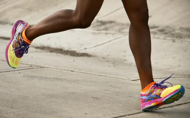 Image of runner's legs in motion wearing ASICS running shoes