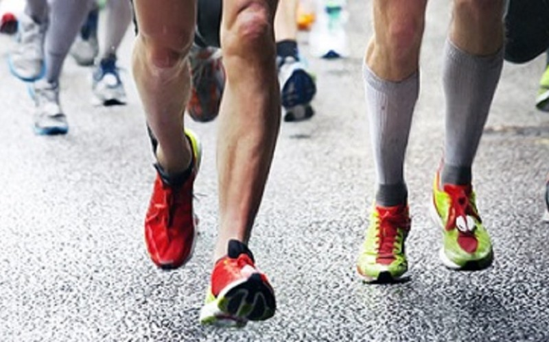 Photo of a group of runners legs