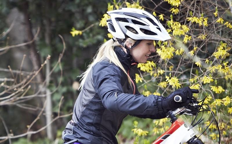 Mountain biker pushing bike uphill