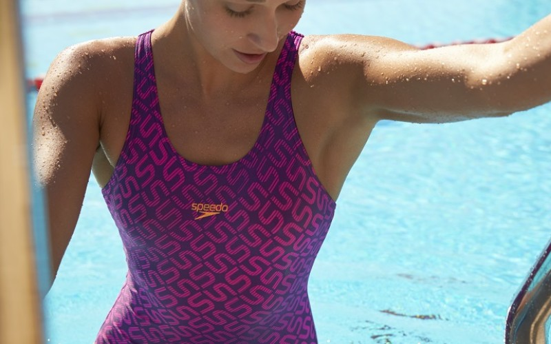 Image of woman leaving pool in Speedo swimsuit