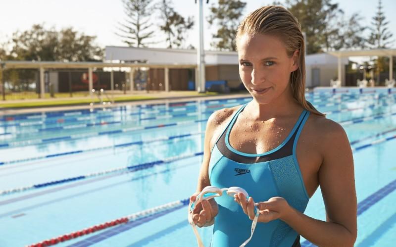 picture of woman in Speedo swimwear posing by pool