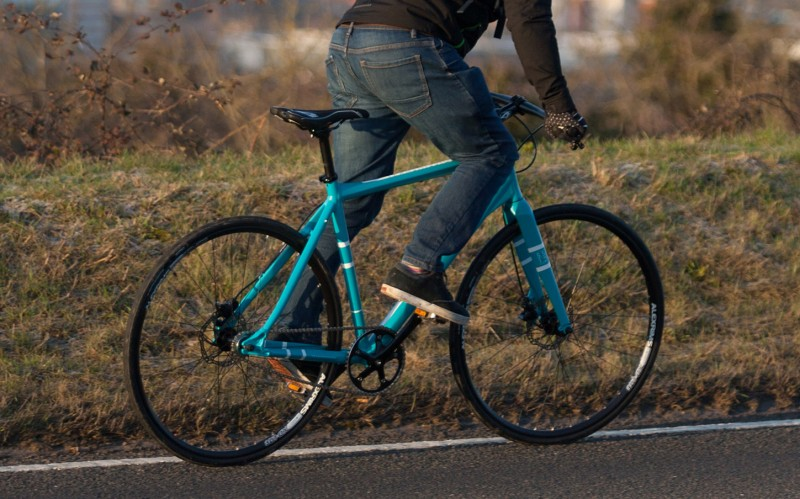 image of man riding a commuter bike