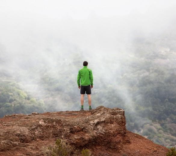 image of man trail running