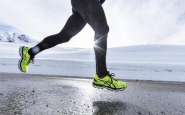 image of runner wearing ASICS run shoes