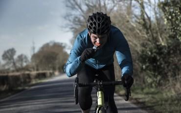 Male cyclist biting into a gel