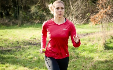 image of woman running outdoors
