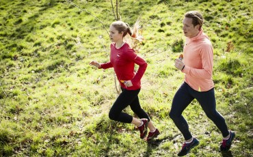 image of couple running together