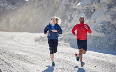Trail running couple running