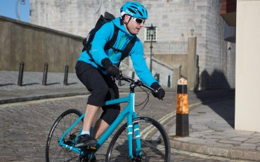 image of man commuting on bike