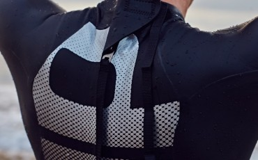 The back of a man wearing a wetsuit