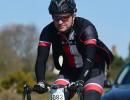 image of Richard Pearman riding his bike wearing Primal cycle jersey