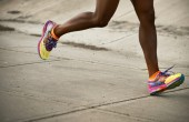 Image of runner's legs in motion wearing ASICS running shoes