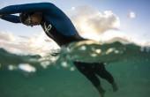 Women swimming wearing Orca wetsuit