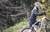 Mountain biker pushing bike uphill