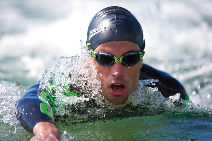 A swimmer wearing full Zoggs kit in action close up